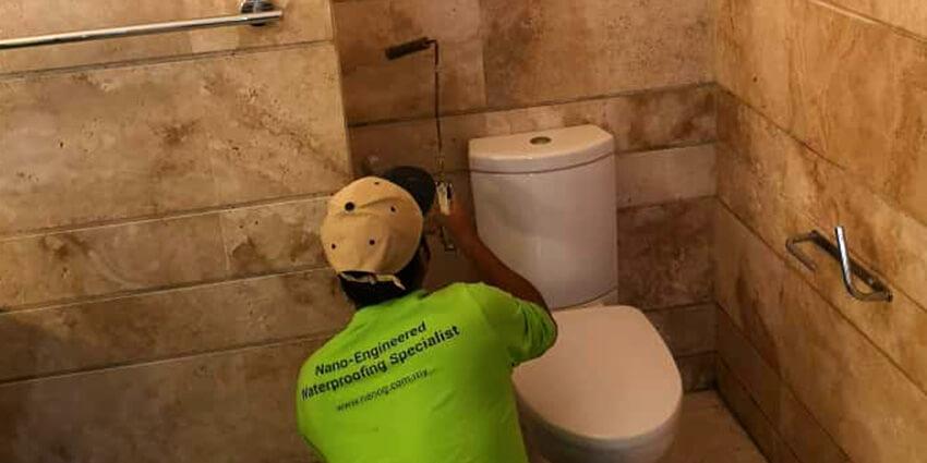 Nano-G's Service Team Waterproofing The Bathroom Walls