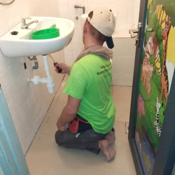 Nano-G Service Team At Work Waterproofing The Bathroom